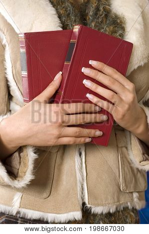 Red books in the women hands,  jacket