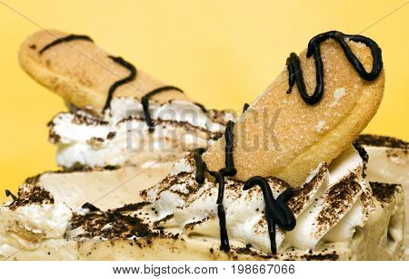 Tasty cake detail isolated on yellow background