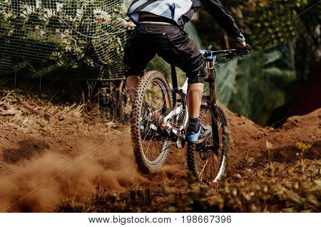 back man rider downhill mountain biking competition