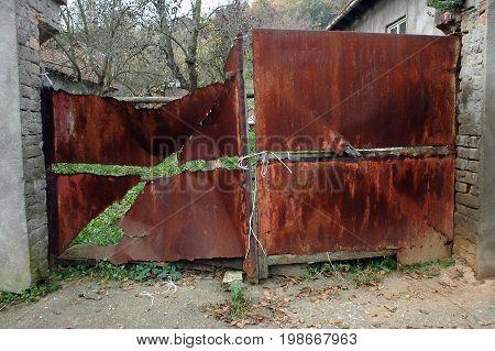 Old gate, brown tin, rusty gate,brown gateway