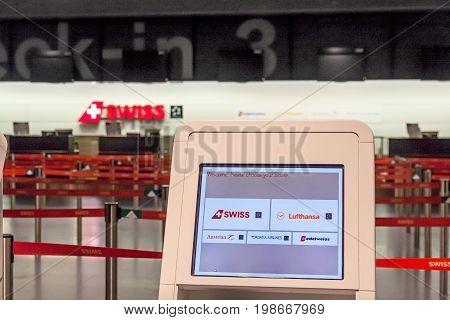 Zurich Switzerland - June 11 2017: Zurich airport Check-in automat check-in desk 3 of swiss airline in background