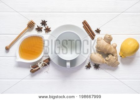 Ingredients for cooking healthy Natural hot beverage. Lemon honey Spices and an empty cup.