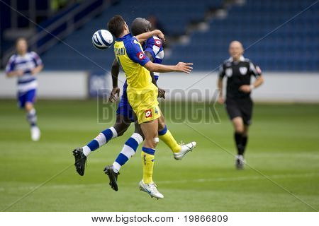 LONDON, UK AUGUST 2, Daniel Parejo and Andrea Mantovani jump for the ball at the pre-season friendly football match between QPR and Chievo,