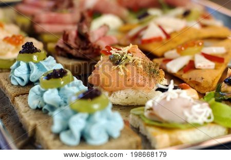 catering appetizer with pork meat and plum