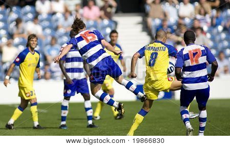 LONDON, UK AUGUST 2, Peter Ramage with a kung fu kick tackle on Gasparetto at the pre-season friendly football match between QPR and Chievo,