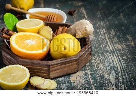 tray with ingredients for making immunity boosting healthy vitamin drink On dark background.