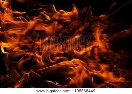 Close up of burning fire over black , detail