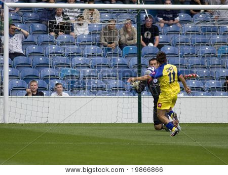 LONDON, UK AUGUST 2,Antimo Lunco attempts to lob Lee Camp at the pre-season friendly football match between QPR and Chievo,