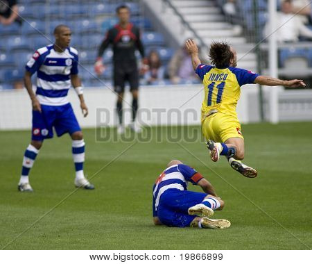 LONDON, UK AUGUST 2,Antimo Lunco flying through the air dramatically after a tackle from Gavin Mahon at the pre-season friendly football match between QPR and Chievo,