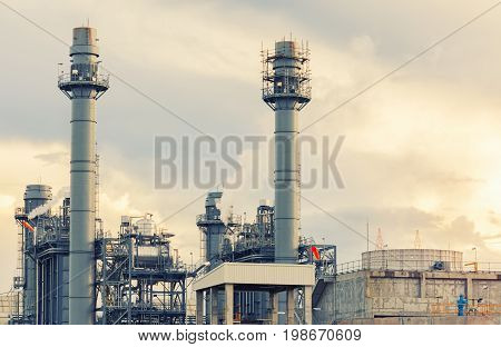 refinery industrial plant power plant at sunset Smoking industrial power plant