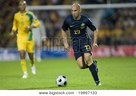 LONDON, UK AUGUST 19, Mark Bresciano running with the ball while playing in the international football friendly match between Australia and South Africa held at Loftus Road London 19/08/2008