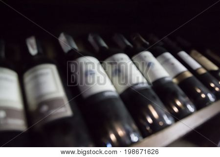 wine bottles lying in a row blurred background