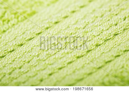 Green cotton fabric texture background. Makro shot.
