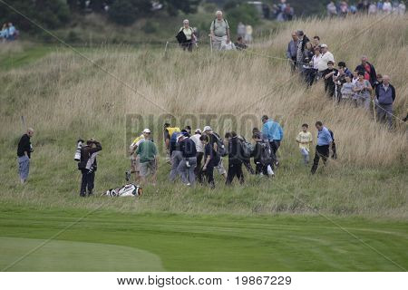 GLENEAGLES SCOTLAND AUGUST 30, Colin Montgomerie helps his fellow Ryder Cup hopeful find his ball on the 2nd hole whilst competing in the Johnnie Walker Classic PGA European Tour golf tournament