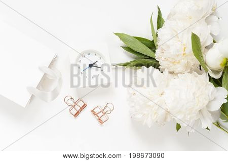 Woman modern background. Flat lay. Flower on the table. Home workplace. Table view. Business accessories. Mock-up background. Peonies. Glamour style.
