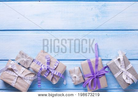 Festive gift boxes with presents on blue wooden background. Selective focus. Place for text. Top view.