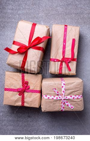Festive gift boxes with presents on grey slate background. Selective focus. Top view.