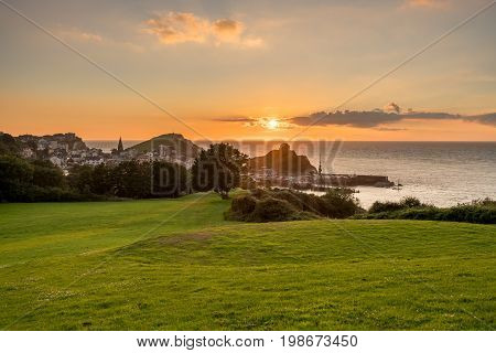 Panorama of the seaside town of Ilfracombe in Devon at sunset with view over harbor and houses