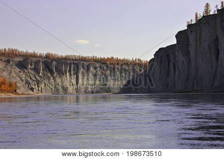Siberian taiga fall river during rafting and fishing. Moiyero river Evenkia Krasnoyarsk region Russia