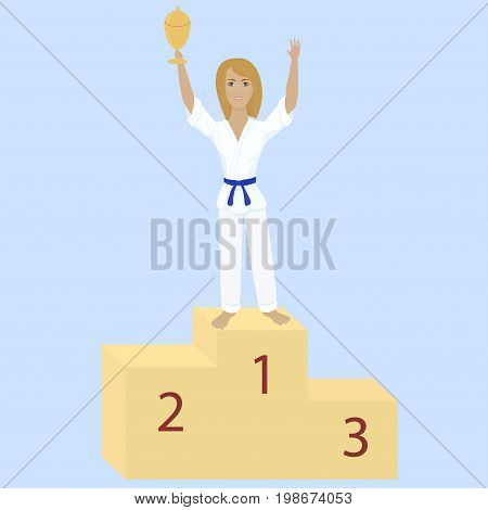 winner karate girl with blue belt and award cup on competition podium