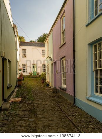 Old stone plaster and painted homes in narrow street in Appledore, Devon