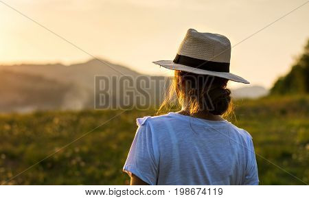 Girl Enjoying Sunset Over A Hill