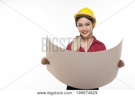 Young Asian woman architect with red shirt and yellow safety helmet smiling while reading blueprints. Industrial occupation people concept