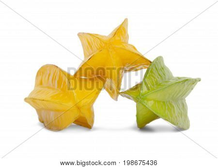 A group of three multi-colored carambolas isolated on a white background. Tasteful and fresh yellow carambola and a juicy, ripe green starfruit. Nutritious fruits for refreshing healthful desserts.