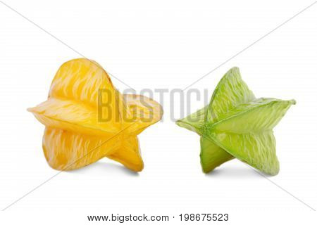 A group of two multi-colored carambolas isolated on a white background. Tasteful and fresh yellow carambola and a juicy, ripe green starfruit. Nutritious fruits for refreshing healthful desserts.