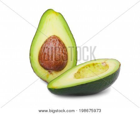 A single green avocado cut in half isolated over the white background. Nutritious and organic avocado for a spicy guacamole sauce. Tropical, ripe and sliced avocado with hard core and juicy texture.