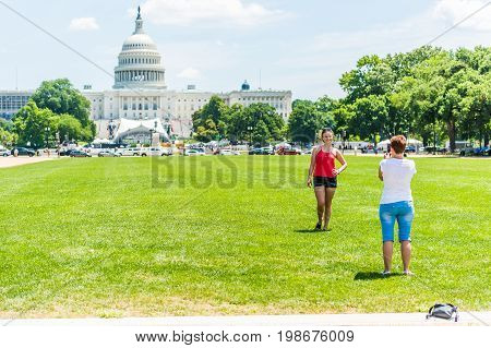 Washington DC USA - July 3 2017: Tourists taking pictures in front of US Capitol building on national mall