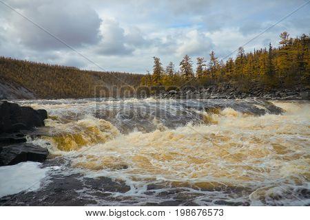 River Moiero and Siberian taiga in the autumn. Evenkiya Krasnoyarsk region Russia