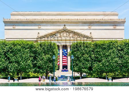 Washington DC USA - July 3 2017: National Archives building in summer with sculpture garden fountain on National Mall