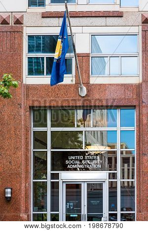 Washington DC USA - July 3 2017: United States Social Security Administration in downtown with flag closeup of sign and building entrance
