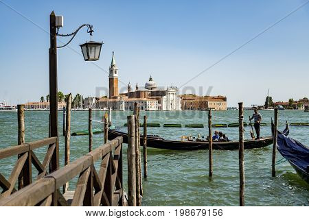 VENICE - JULY 1: beautiful view of the canal with a floating gondola on July 1 2017 in Venice Italy