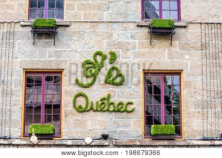 Quebec City Canada - May 30 2017: J'aime Quebec sign on wall in green grass lettering with heart