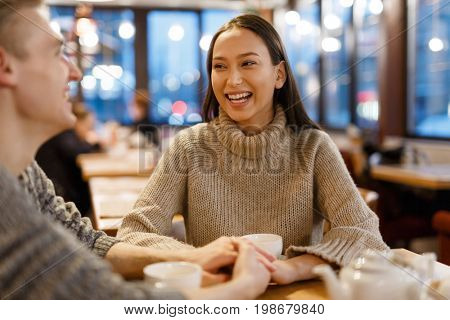 Young amorous couple having tea and rest in cafe