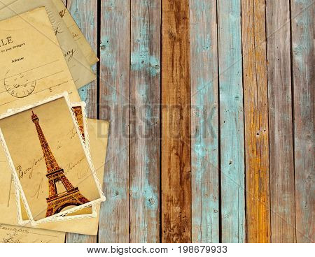 Old retro grunge cards with landmark of Paris - Eiffel tower, on wooden planks