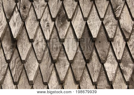 An ancient wooden tiled roof, traditional for the historical area Maramures, Romania, Europe