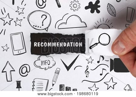 Business, Technology, Internet And Network Concept. Young Businessman Shows The Word: Recommendation