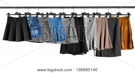 Group of skirts on clothes racks isolated over white