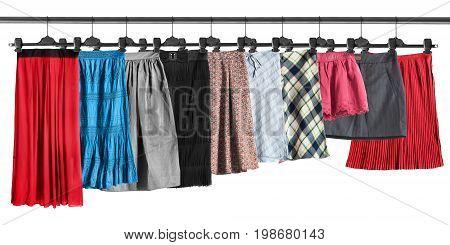 Set of skirt on clothes racks on white background