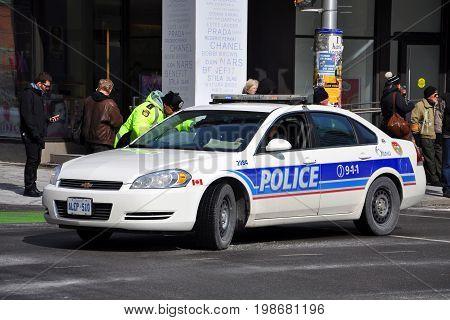 OTTAWA, CANADA - MAR. 10, 2012: Ottawa Police Ford Crown Victoria Police Car in downtown Ottawa, Ontario, Canada.