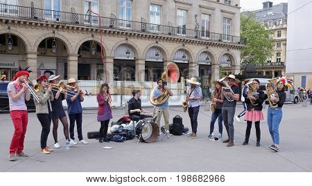 ParisFrance- April 29 2017: Performance of the brass band on Rivoli Street. On the street pedestrians and transport