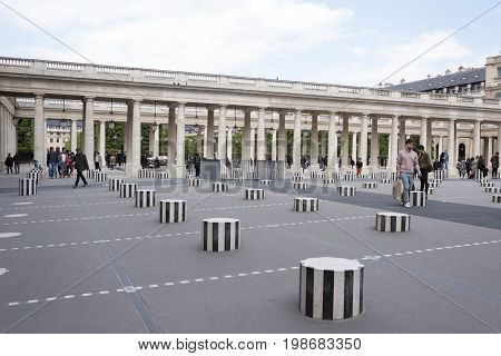 ParisFrance- April 29 2017: Les Deux Plateaux; art installation by Daniel Buren in the inner courtyard of the Palais Royal .This artwork was created in 1985-1986