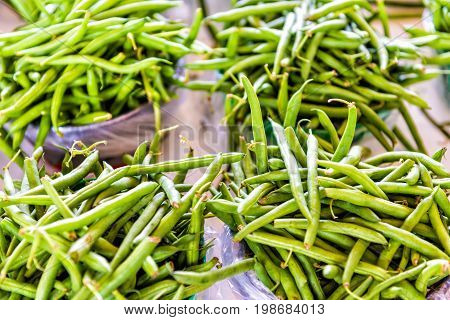 Closeup Of Green Beans On Display At Farmer's Market In Baskets