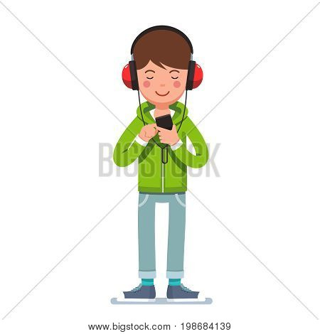 Teen boy in headphones listening to music on mobile phone. Man wearing hoodie, jeans and kids standing and tapping smartphone. Flat style character vector illustration isolated on white background.