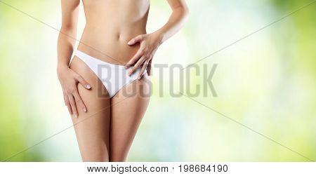 beautiful woman body on green background body care concept