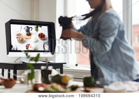 Computer monitor on workplace of food designer and photographer shooting food