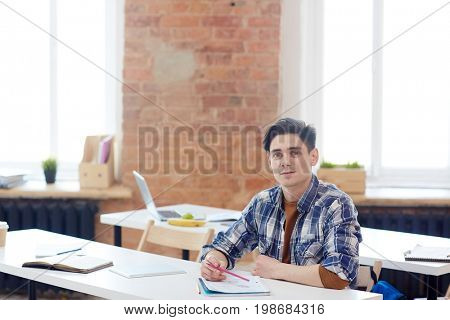 Intellectual employee taking course of study in technical school